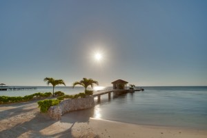 Coco Beach Resort Luxury Belize Resort Sunrise over Dock
