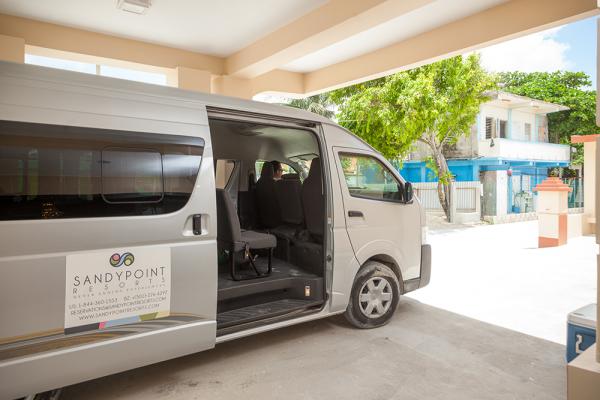 Sandy-Point-Resort-Van-transfer-to-resort