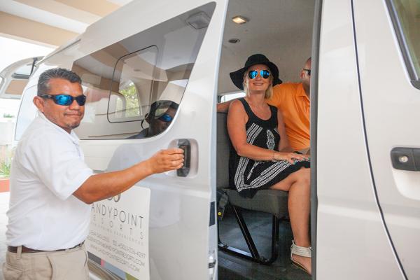 Sandy-Point-Resorts-Guest-boarding-transfer-van-
