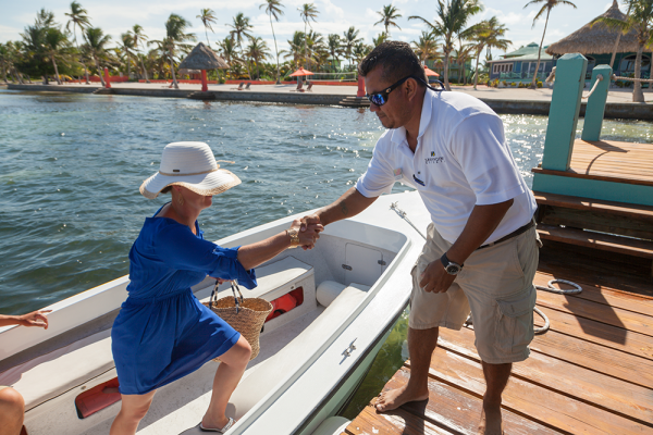 Sandy-Point-Resorts-guest-getting-off-boat-at-resort